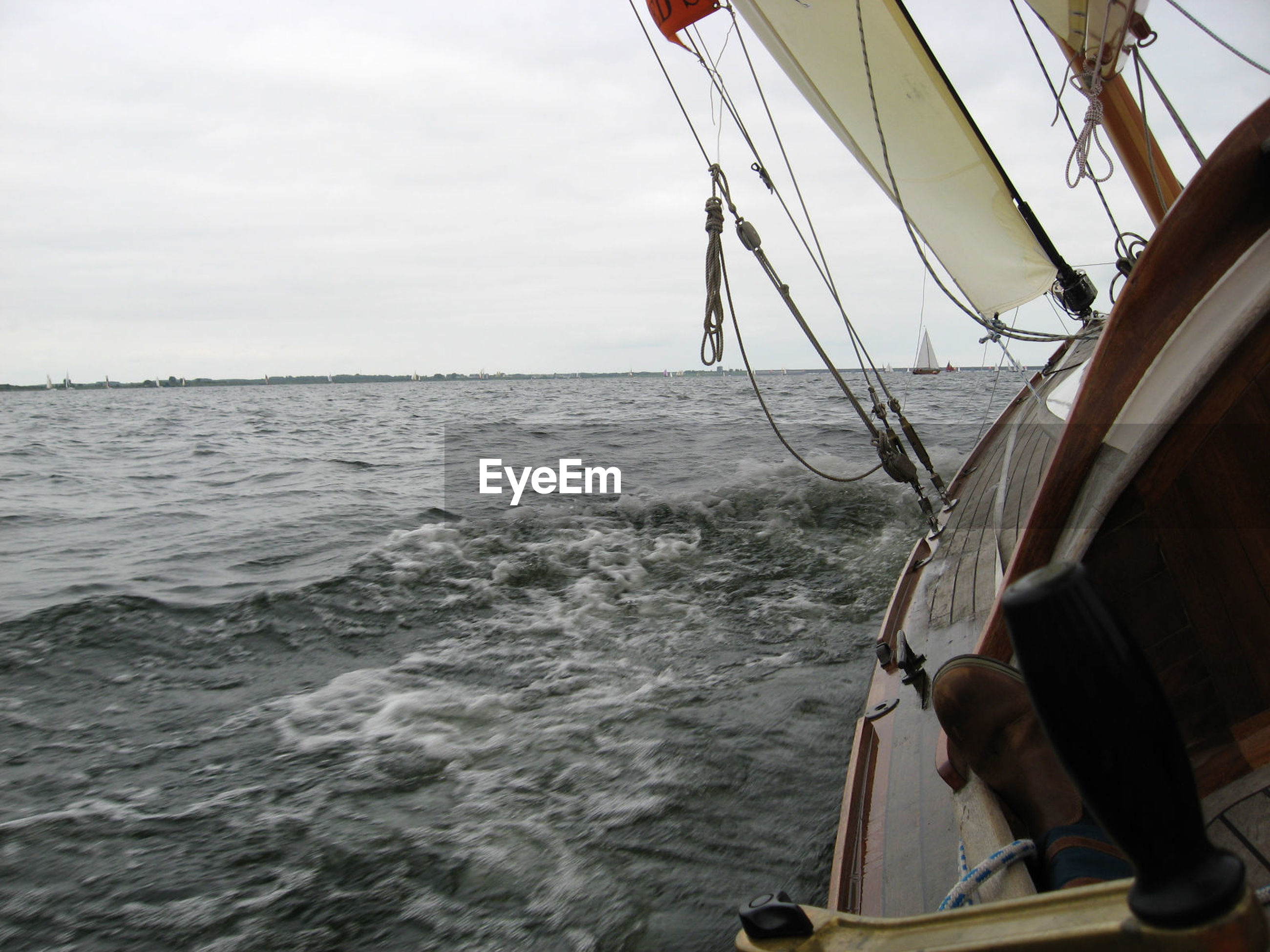 Cropped image of boat sailing in sea