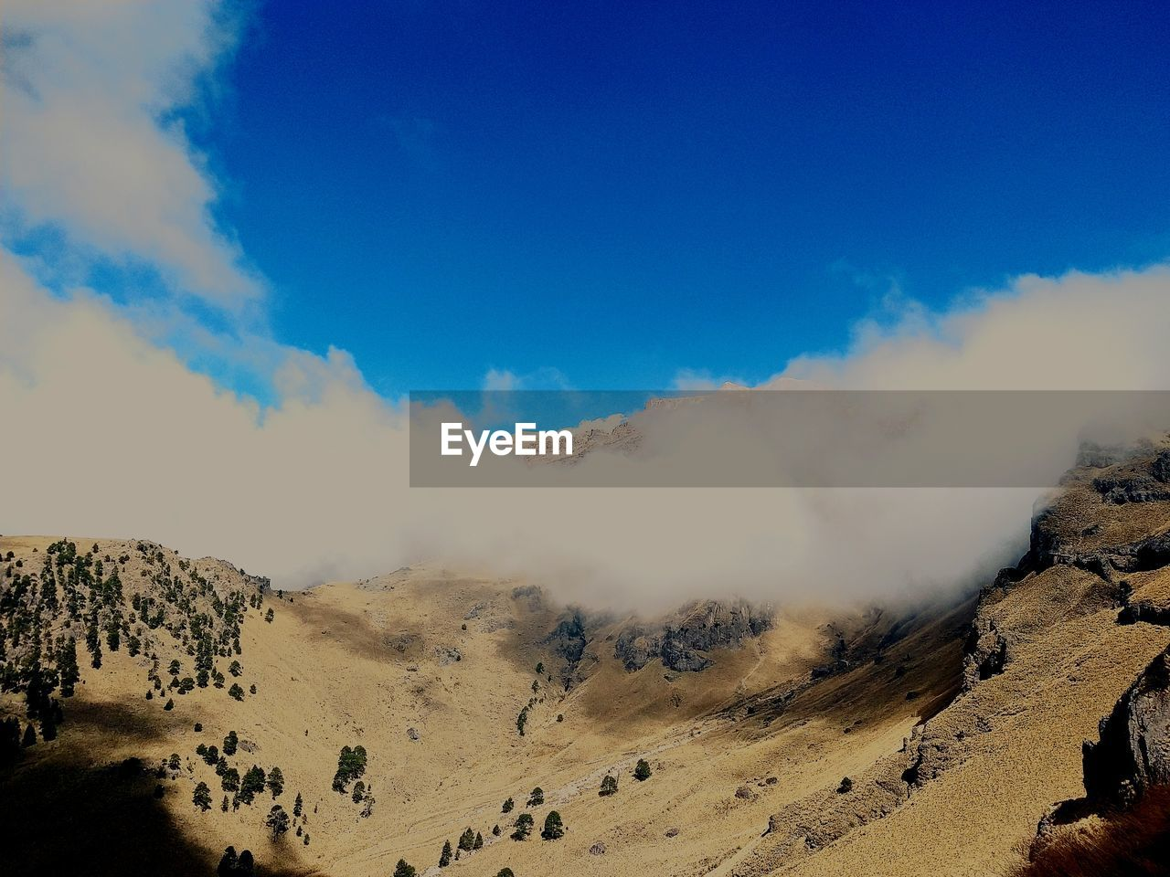 sky, beauty in nature, scenics - nature, cloud - sky, tranquil scene, tranquility, non-urban scene, mountain, landscape, environment, nature, day, blue, physical geography, idyllic, no people, remote, geology, desert, land, outdoors, arid climate, climate, power in nature