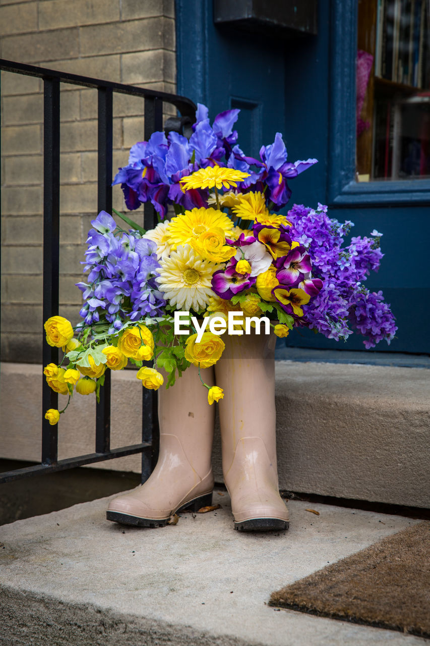 flowering plant, flower, plant, freshness, nature, vulnerability, fragility, yellow, beauty in nature, day, flower arrangement, close-up, flower head, vase, growth, outdoors, no people, decoration, multi colored, purple, bouquet, bunch of flowers, springtime, flower pot