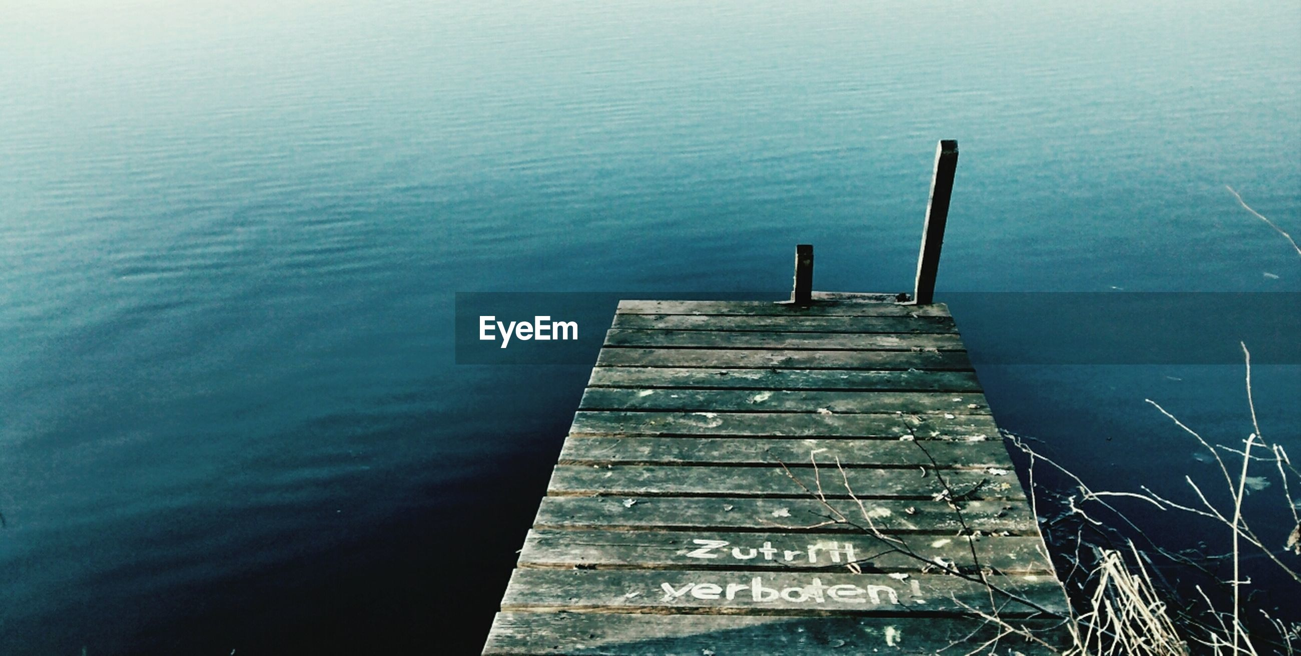 water, pier, wood - material, lake, the way forward, tranquility, jetty, high angle view, built structure, nature, steps, sea, rippled, railing, outdoors, tranquil scene, day, wood, wooden, river