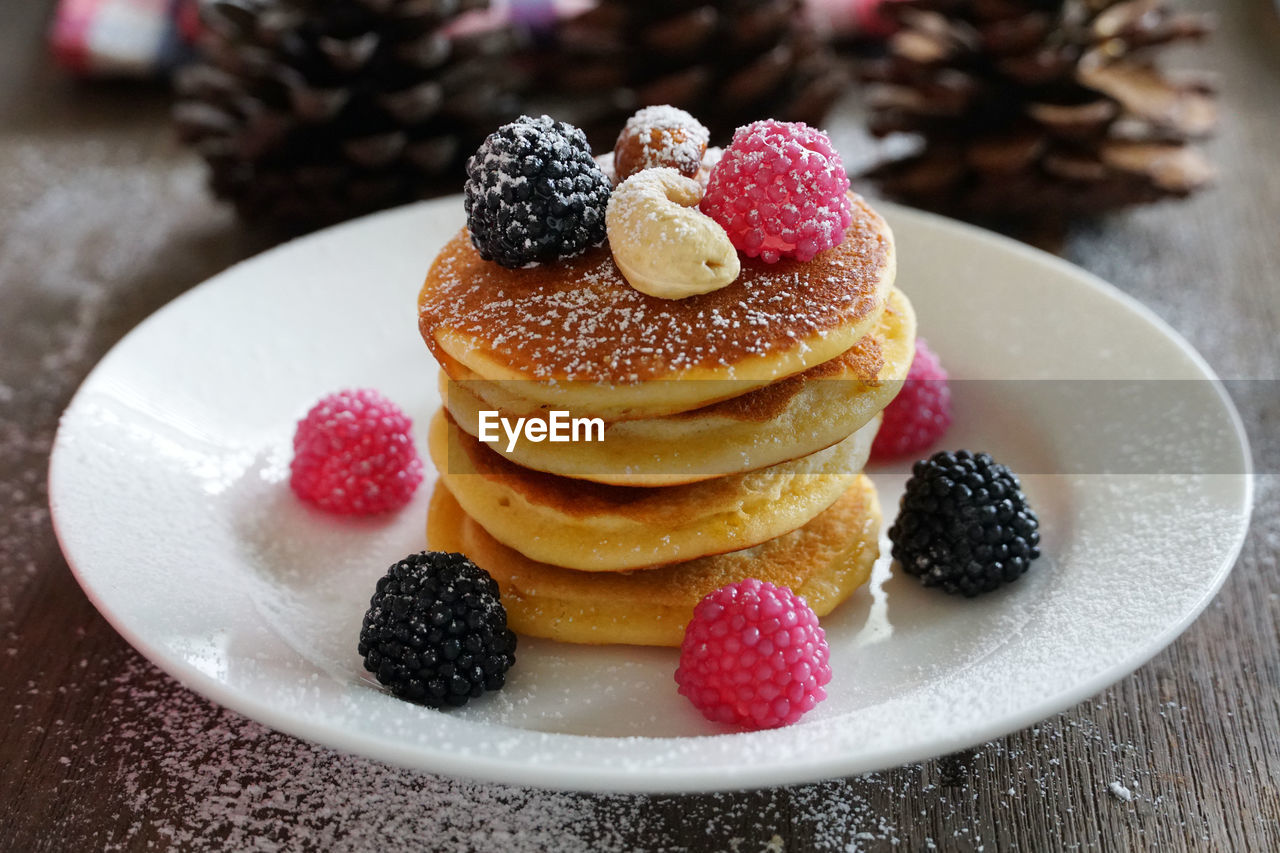 food and drink, food, sweet food, fruit, dessert, sweet, freshness, berry fruit, temptation, indulgence, plate, cake, ready-to-eat, indoors, close-up, still life, table, blueberry, unhealthy eating, pancake, no people, powdered sugar