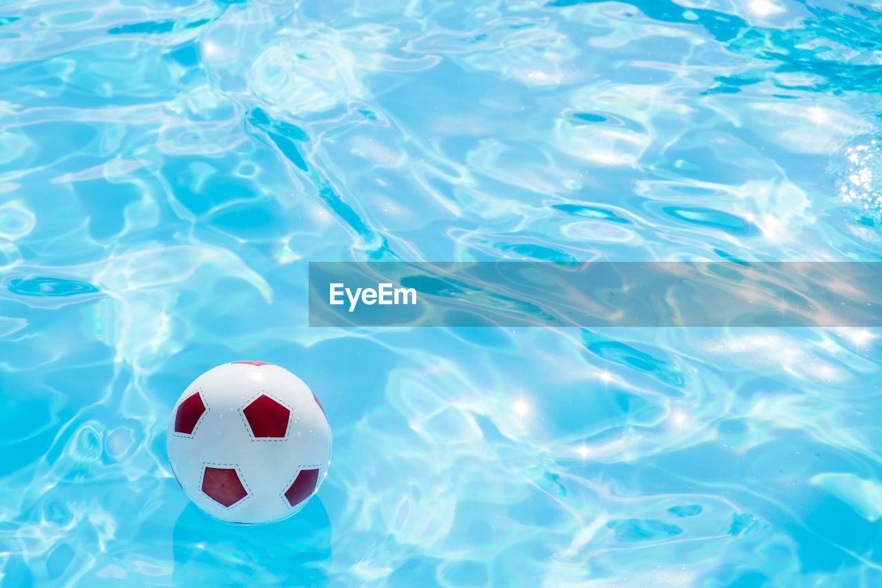 Ball Floating In Swimming Pool