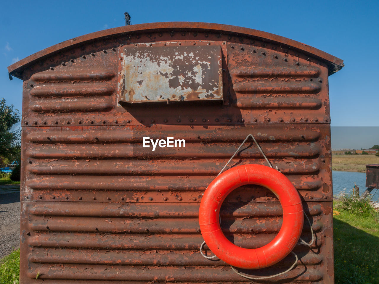 Red Inflatable Ring On Rusty Built Structure