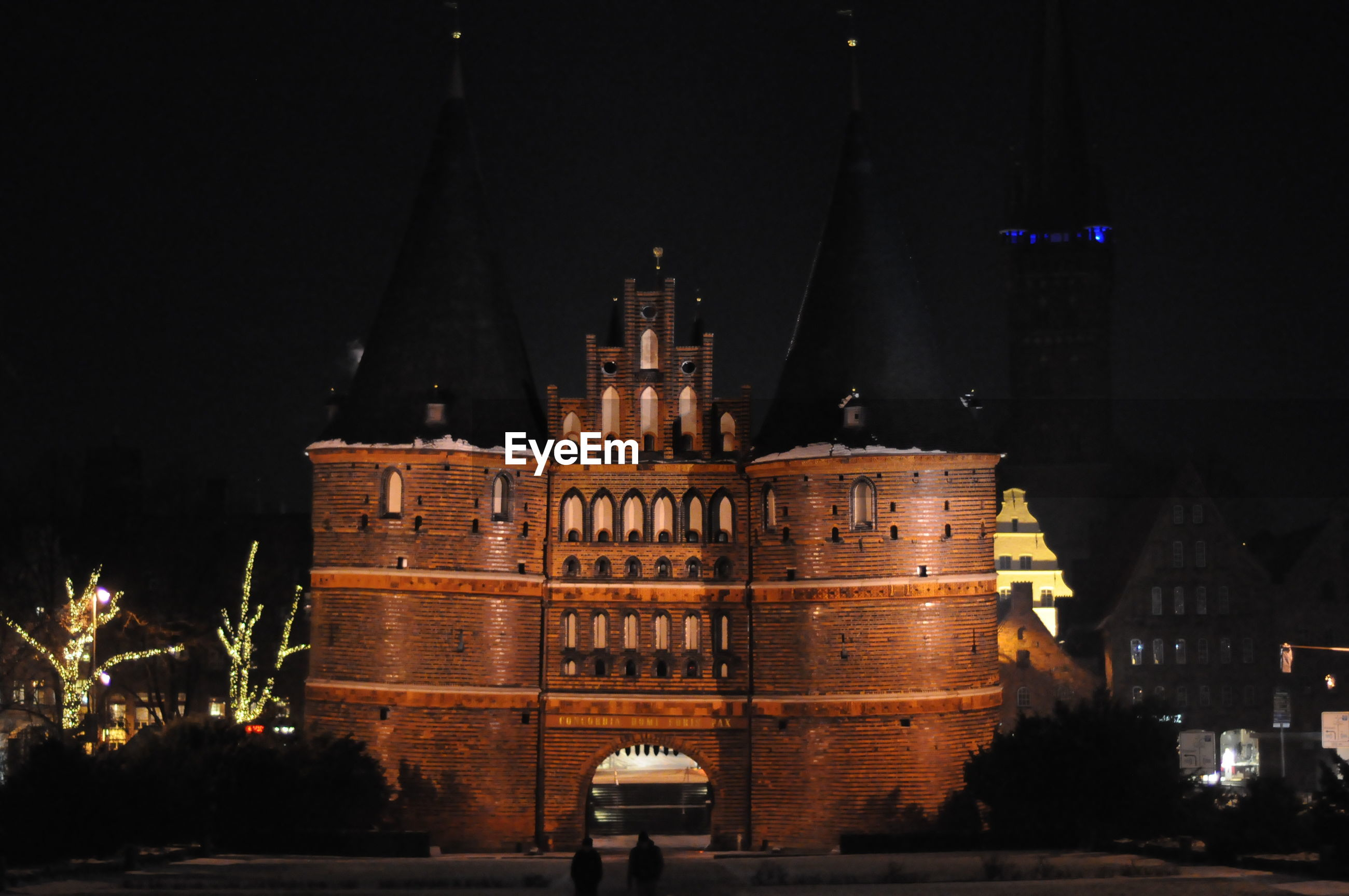 Holstentor against sky in city at night