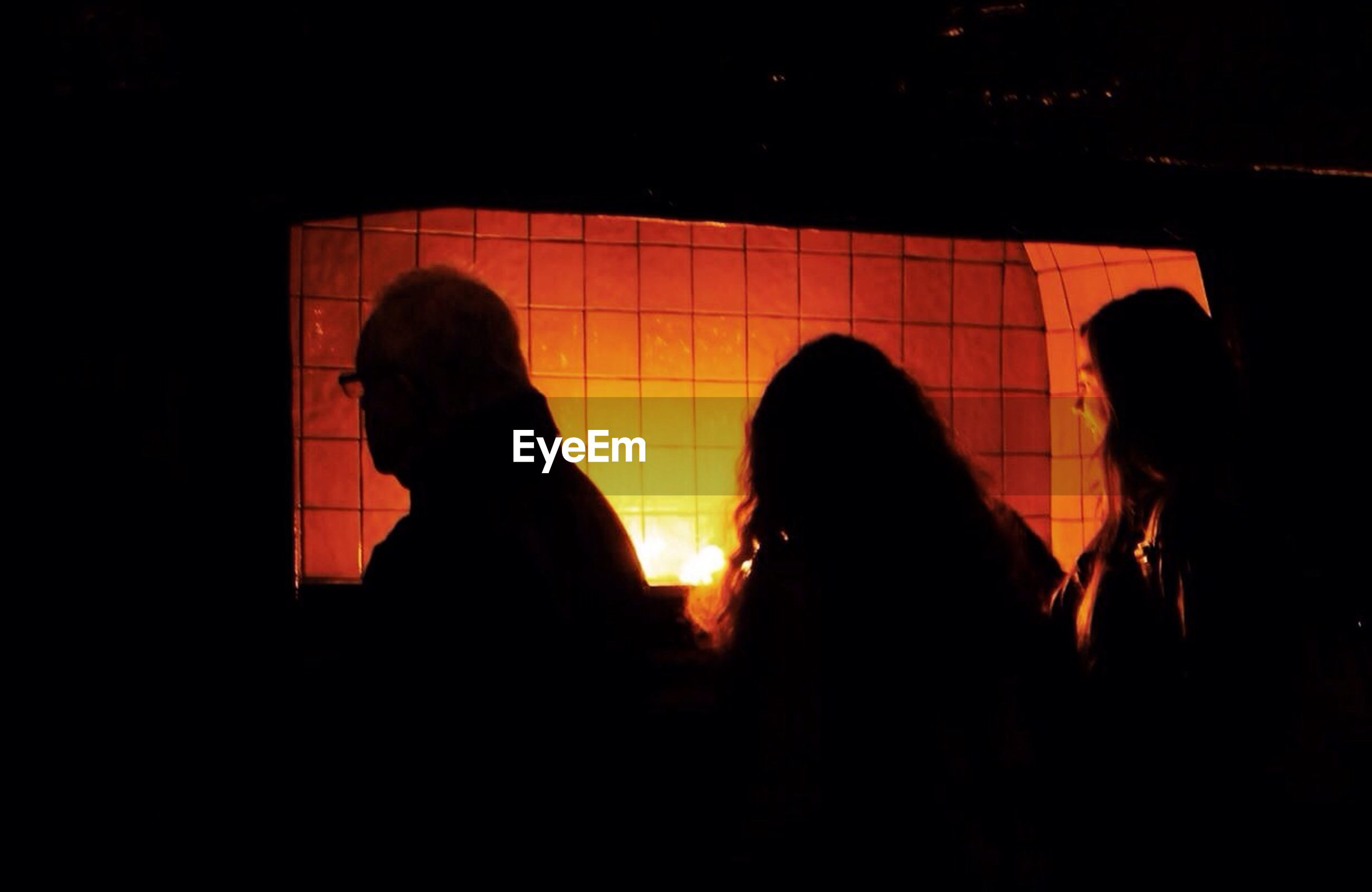 silhouette, three people, indoors, illuminated, real people, day