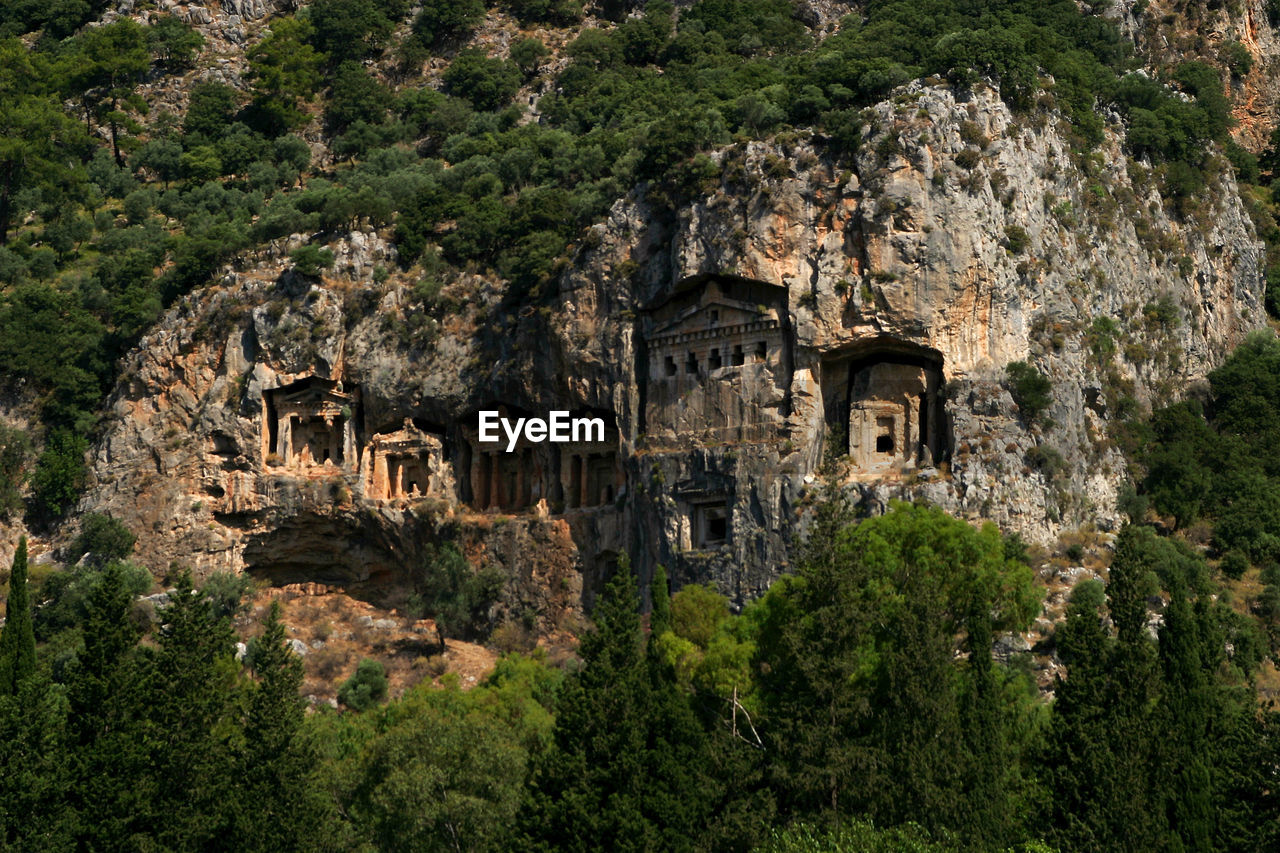 architecture, building, history, the past, built structure, solid, building exterior, no people, tree, plant, mountain, travel destinations, nature, rock - object, rock, ancient, residential district, travel, outdoors, day, ancient civilization, archaeology