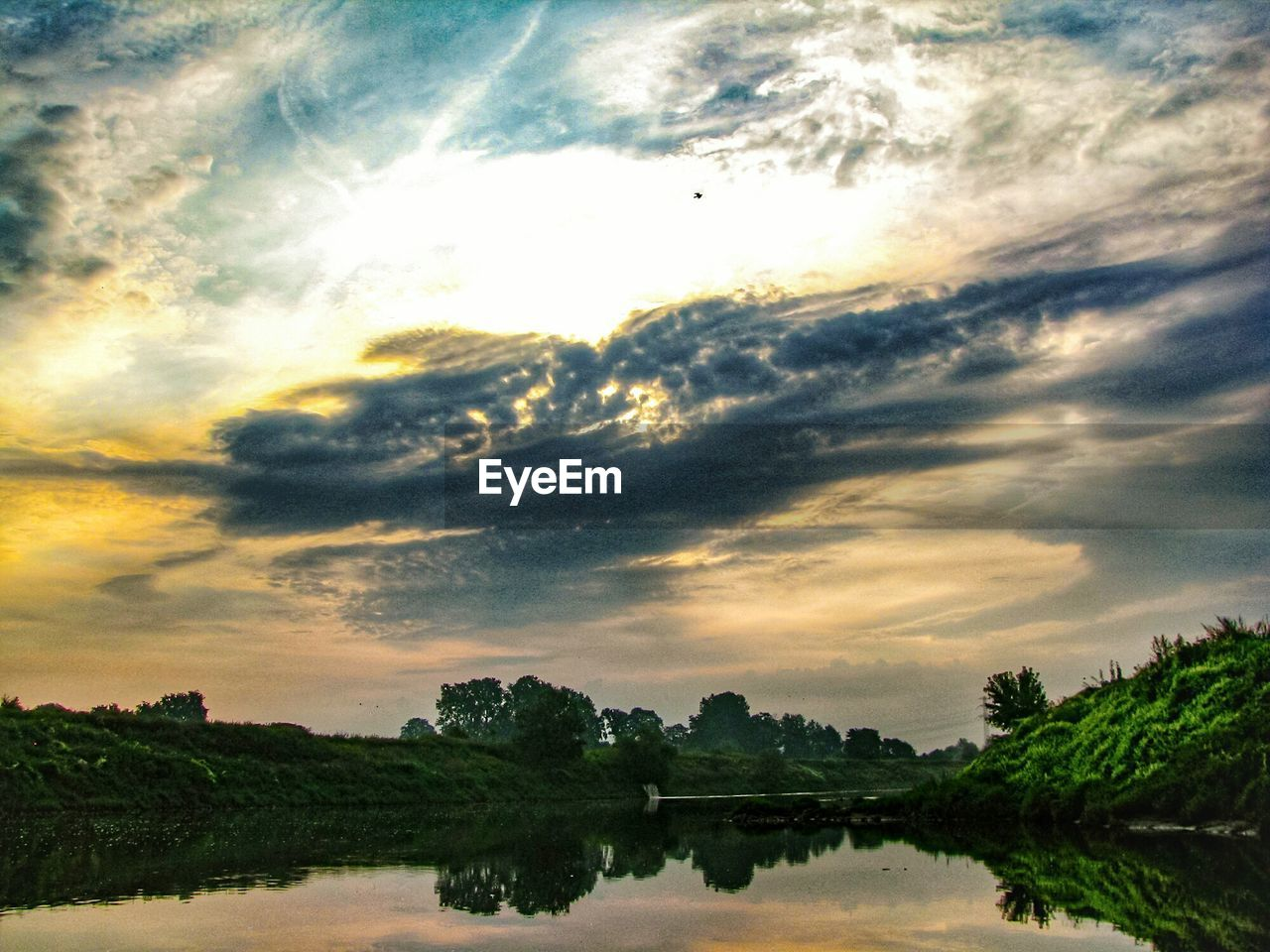 sky, cloud - sky, beauty in nature, tranquility, scenics - nature, tranquil scene, sunset, nature, tree, water, plant, no people, non-urban scene, reflection, environment, idyllic, landscape, lake, outdoors