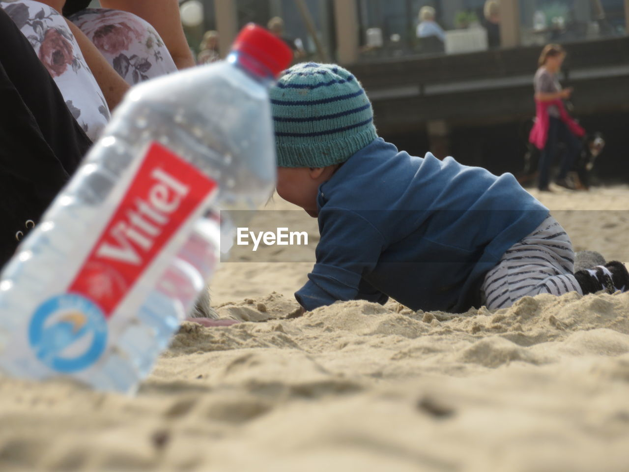 real people, sand, men, land, males, selective focus, childhood, child, beach, people, lifestyles, day, leisure activity, incidental people, boys, text, innocence, nature, western script, warm clothing