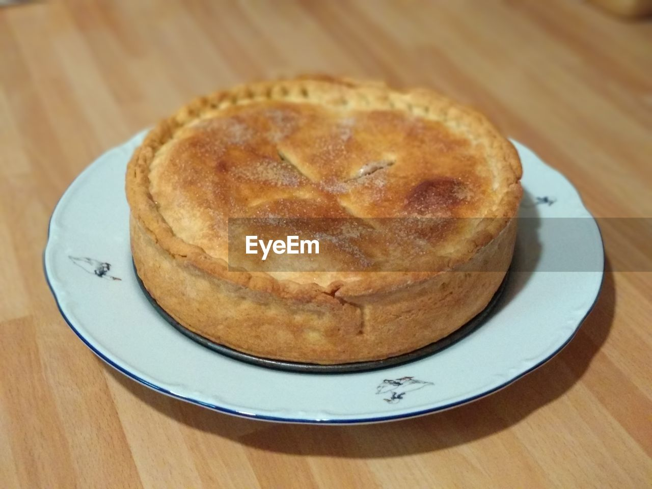 food and drink, food, sweet food, table, freshness, dessert, plate, indulgence, indoors, sweet, still life, baked, wood - material, ready-to-eat, close-up, high angle view, no people, temptation, focus on foreground, pie, snack