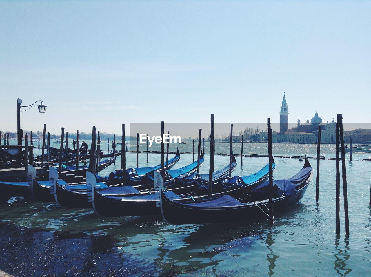 Gondolas moored in river