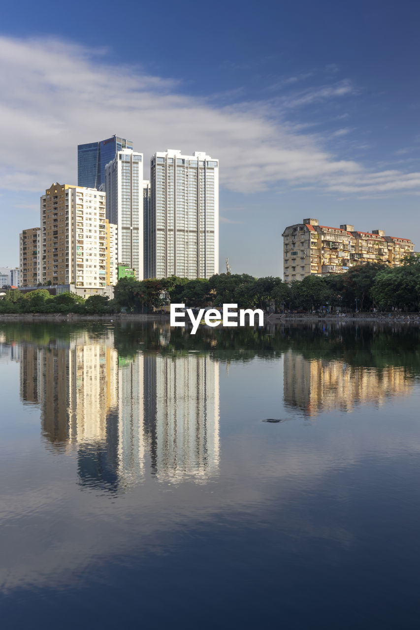architecture, building exterior, built structure, water, reflection, building, waterfront, sky, city, nature, no people, cloud - sky, office building exterior, river, outdoors, day, modern, residential district, skyscraper
