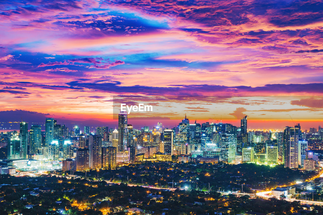 building exterior, architecture, city, built structure, building, cityscape, sky, cloud - sky, office building exterior, sunset, illuminated, skyscraper, tall - high, modern, night, urban skyline, nature, no people, tower, residential district, outdoors, financial district