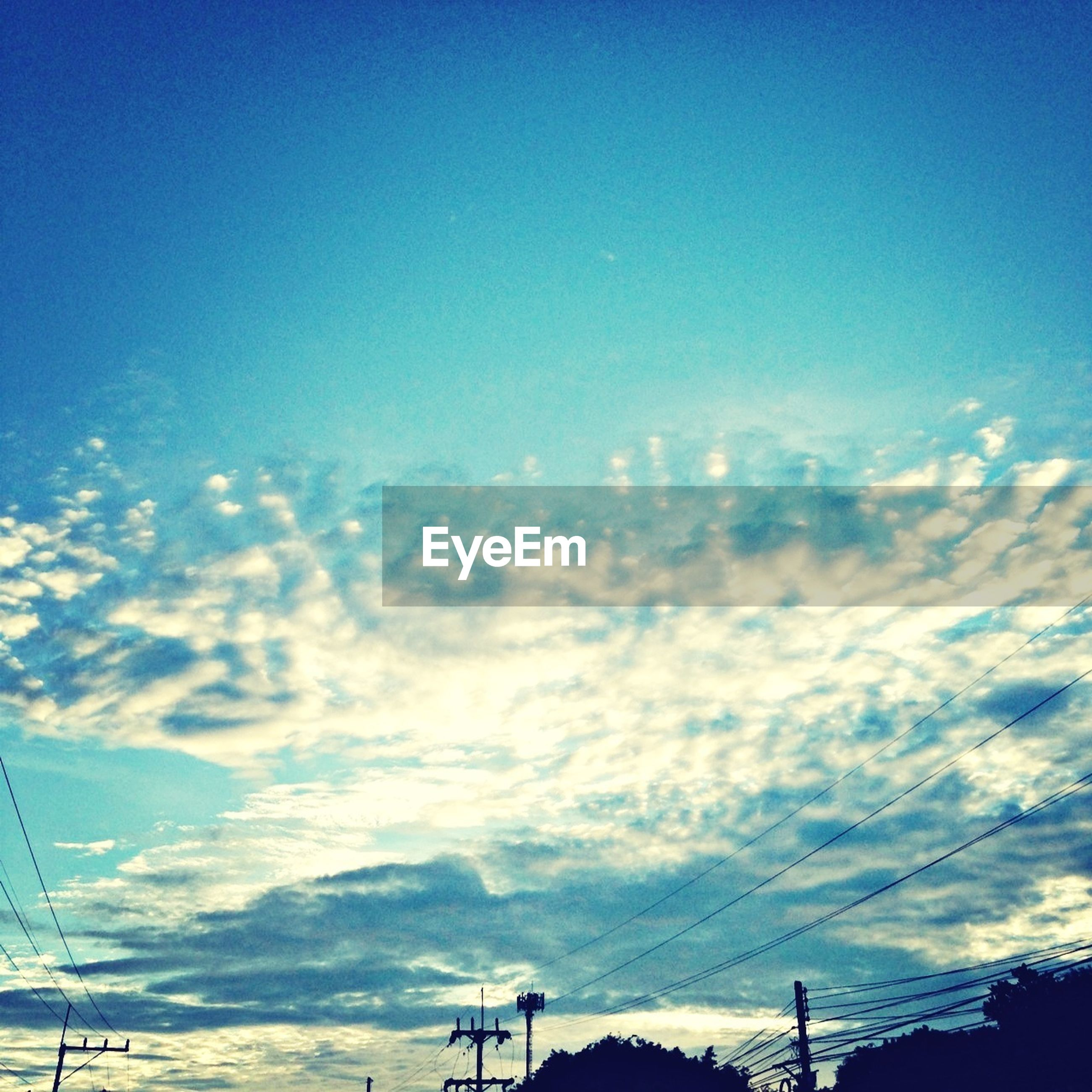sky, power line, blue, electricity pylon, low angle view, cloud - sky, electricity, silhouette, power supply, tranquility, beauty in nature, scenics, sunset, connection, tranquil scene, nature, cloud, cable, outdoors, no people