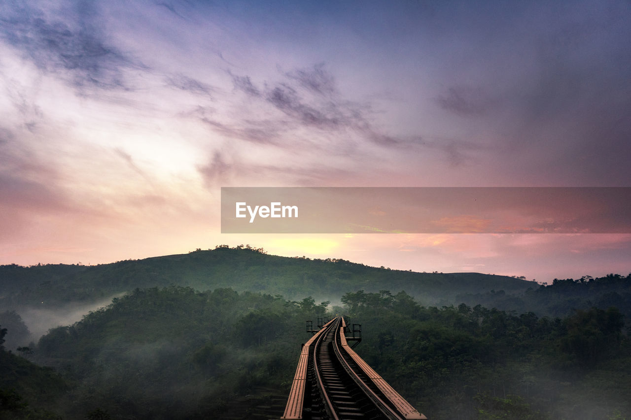 High Angle View Of Railroad Track Against Sky During Sunset