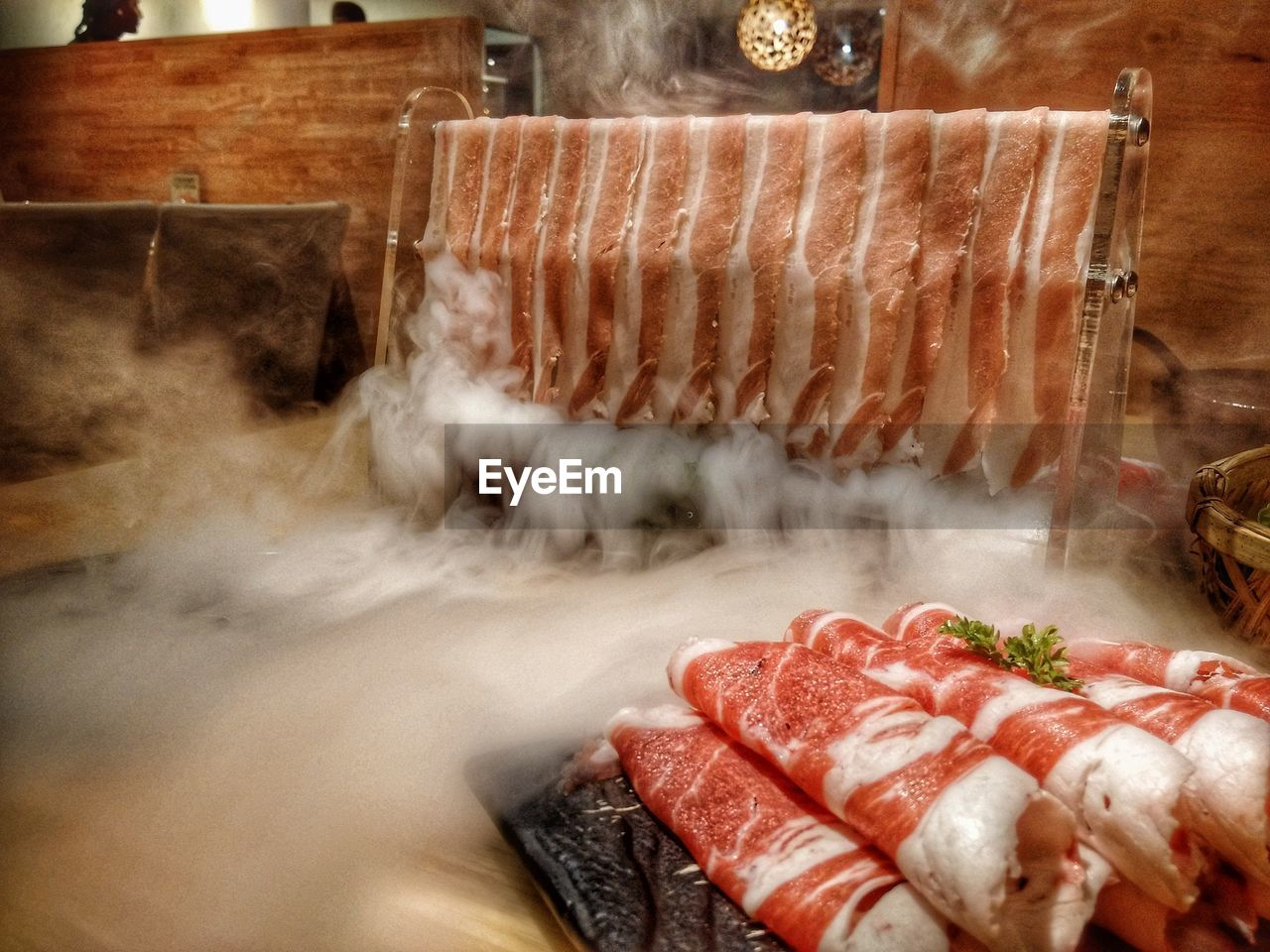 Close-up of steam over meat on table in restaurant