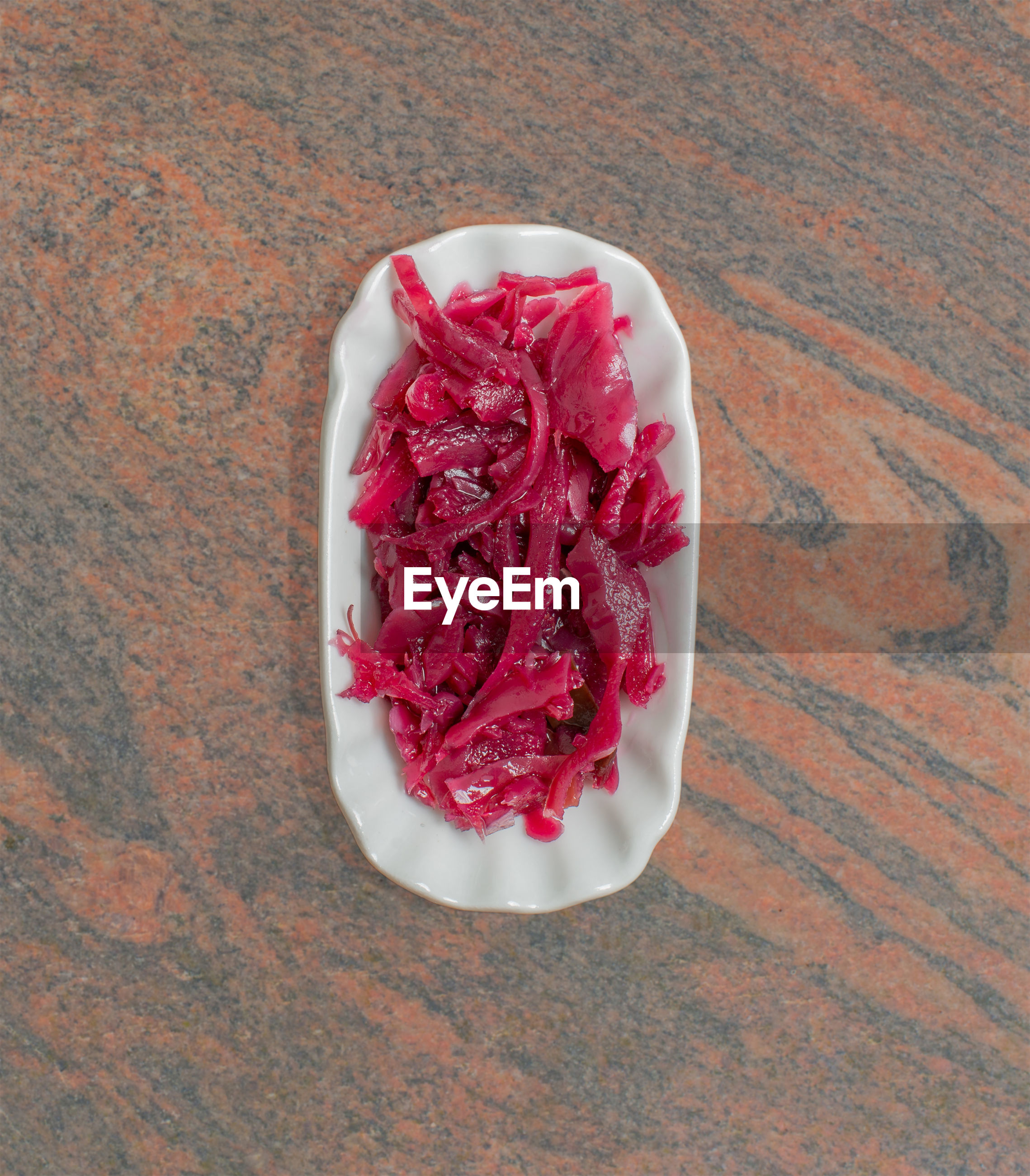 Red cabbage in a white bowl for food photography