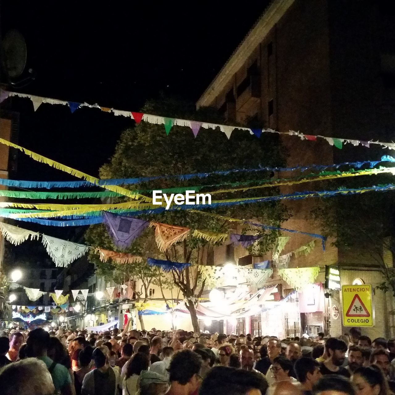 large group of people, crowd, event, night, real people, celebration, fun, lifestyles, leisure activity, women, hanging, watching, spectator, arts culture and entertainment, audience, outdoors, men, togetherness, illuminated, performance, multi colored, architecture, people