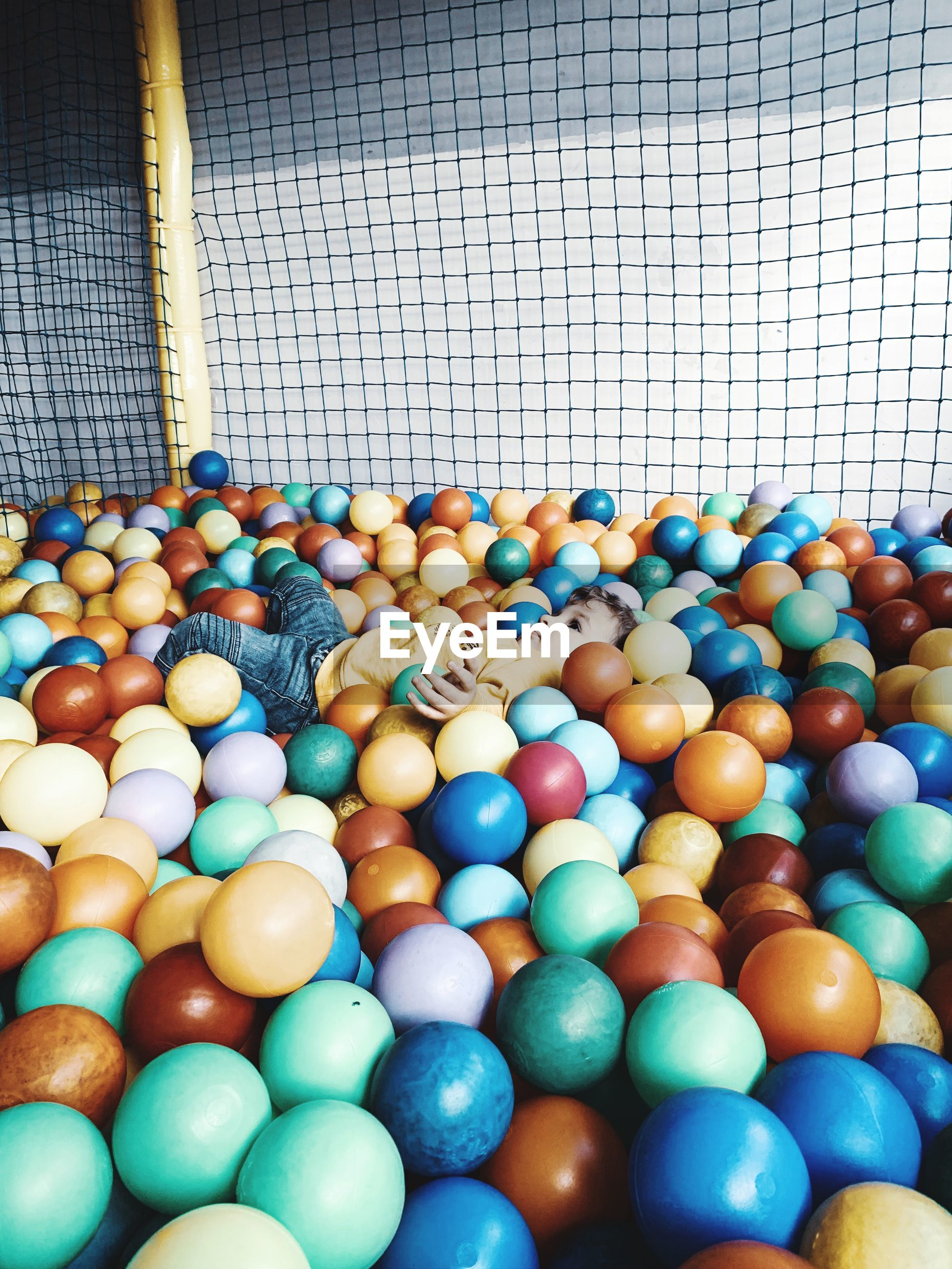 High angle view of boy in ball pool