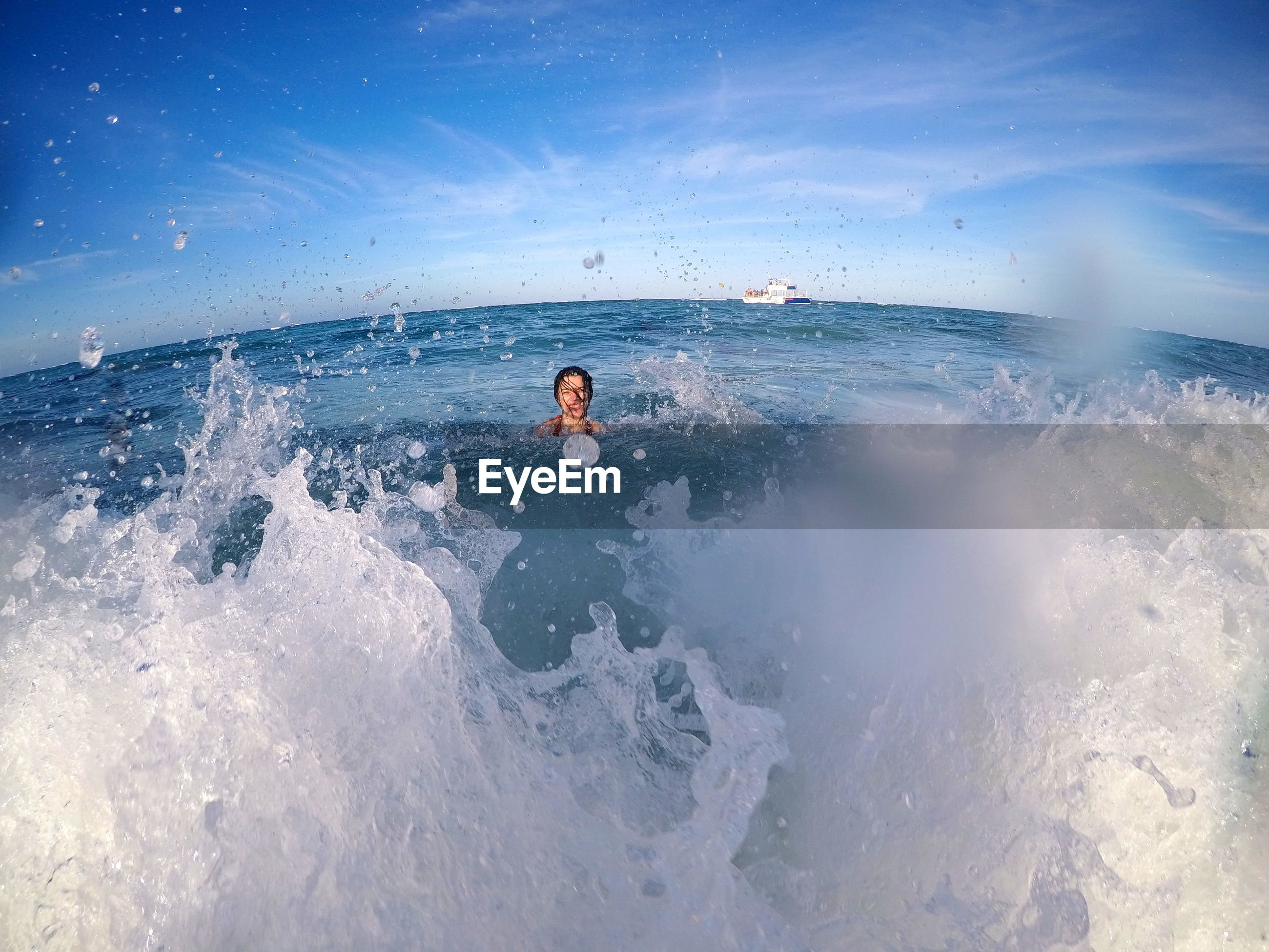 Water splashing on woman in sea