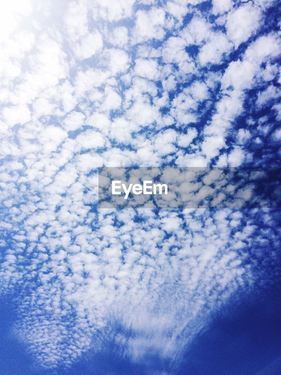 sky, cloud - sky, beauty in nature, blue, nature, low angle view, backgrounds, no people, scenics, sky only, cloudscape, tranquility, tranquil scene, abstract, day, full frame, outdoors, close-up, vapor trail