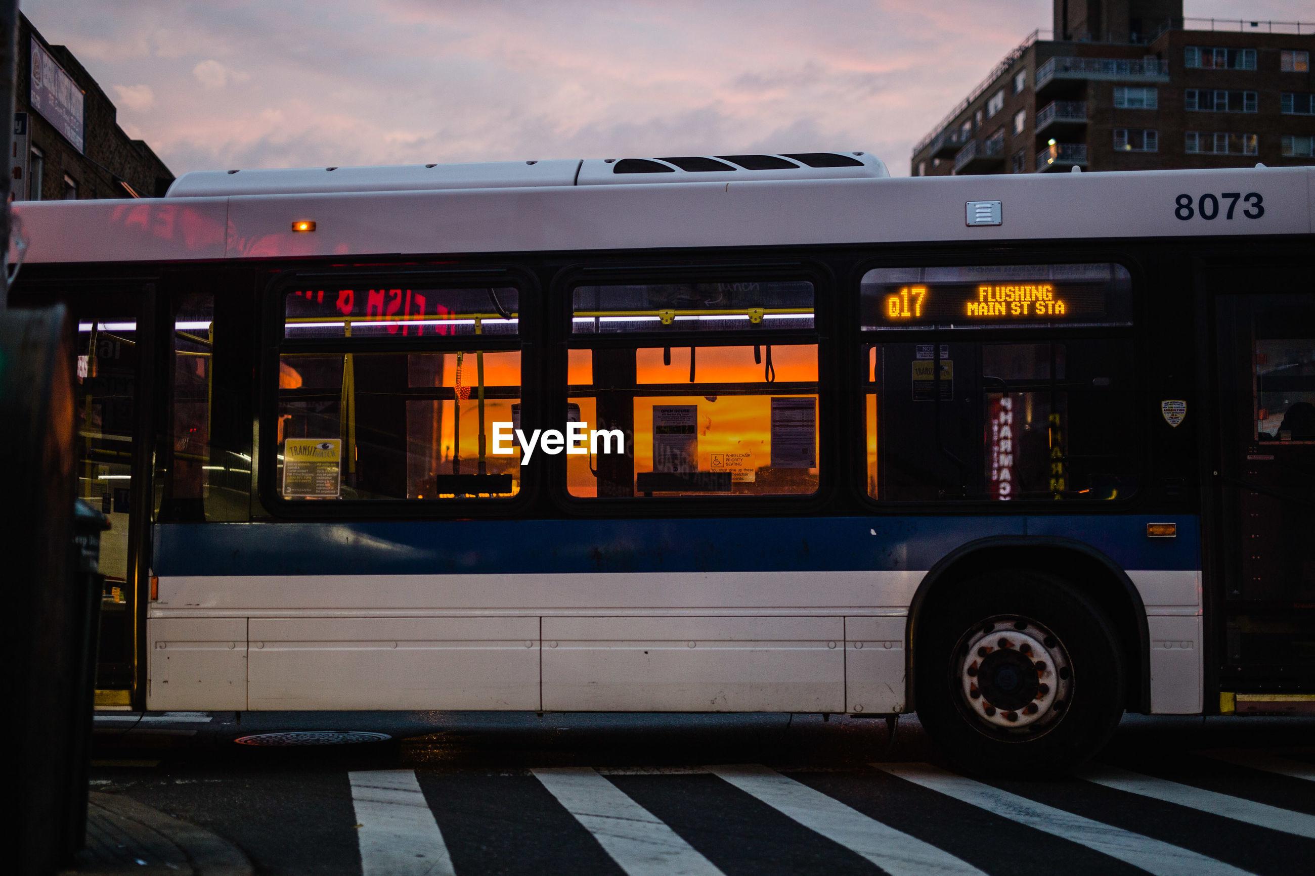 BUS AGAINST SKY ON CAR