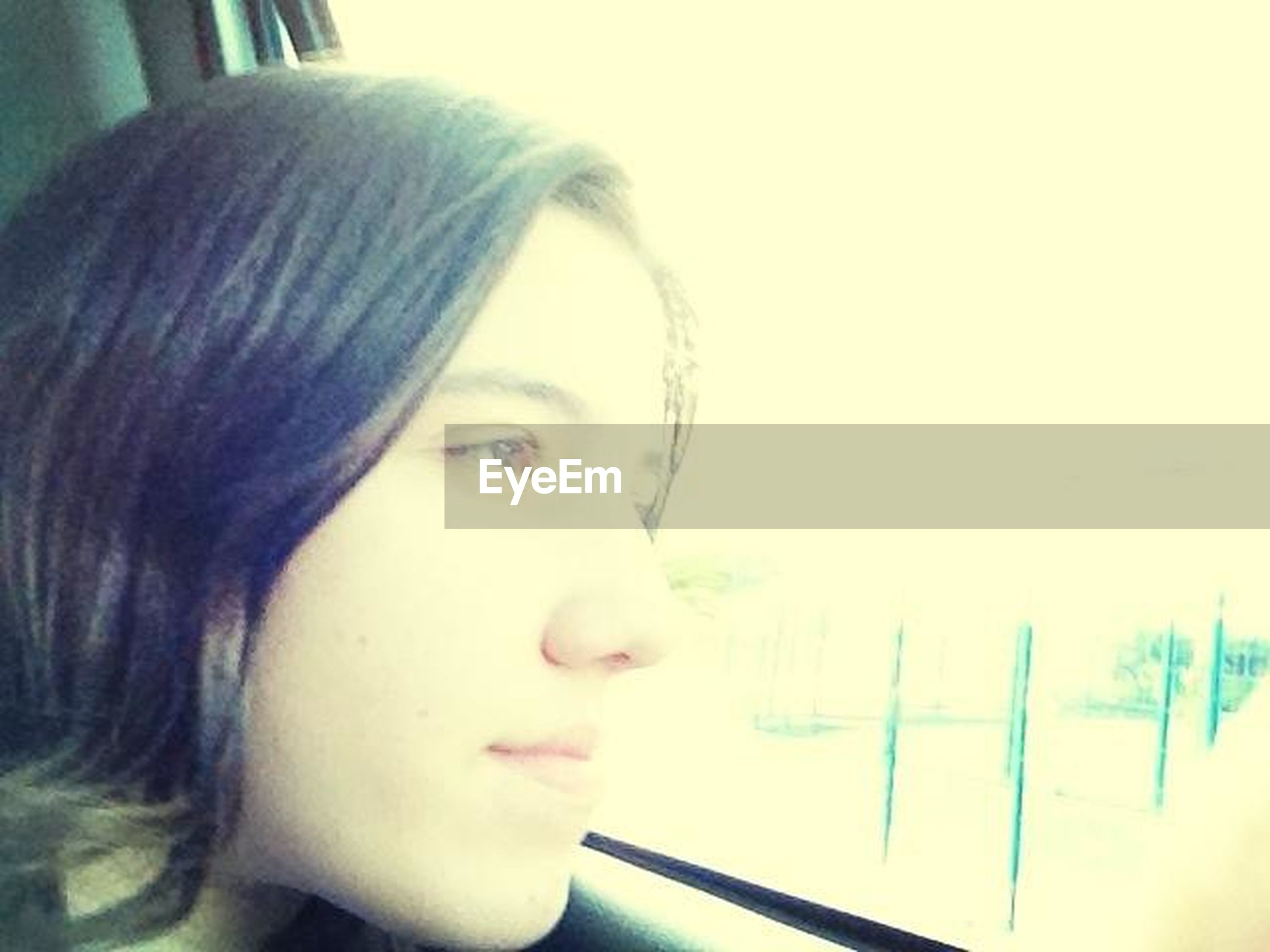 indoors, headshot, young adult, person, lifestyles, young women, close-up, portrait, window, contemplation, looking at camera, head and shoulders, front view, leisure activity, focus on foreground, human face, long hair