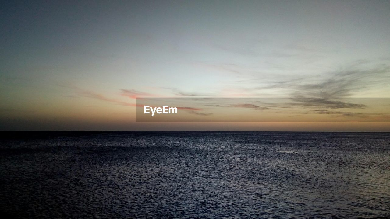 sea, sunset, scenics, horizon over water, tranquil scene, water, beauty in nature, tranquility, nature, sky, idyllic, cloud - sky, no people, silhouette, rippled, beach, outdoors, day