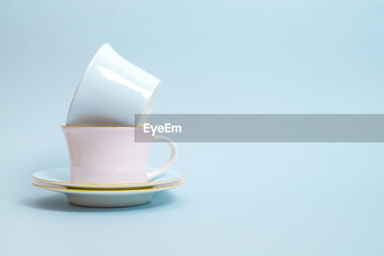 CLOSE-UP OF COFFEE CUP AND WHITE BACKGROUND