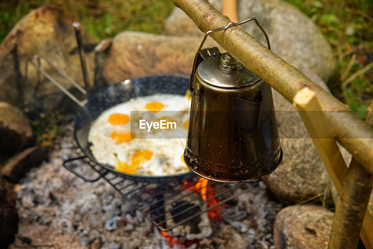 kitchen utensil, food and drink, household equipment, nature, high angle view, no people, motion, day, focus on foreground, food, heat - temperature, preparation, close-up, metal, water, container, outdoors, burning, solid, preparing food, flowing, flowing water