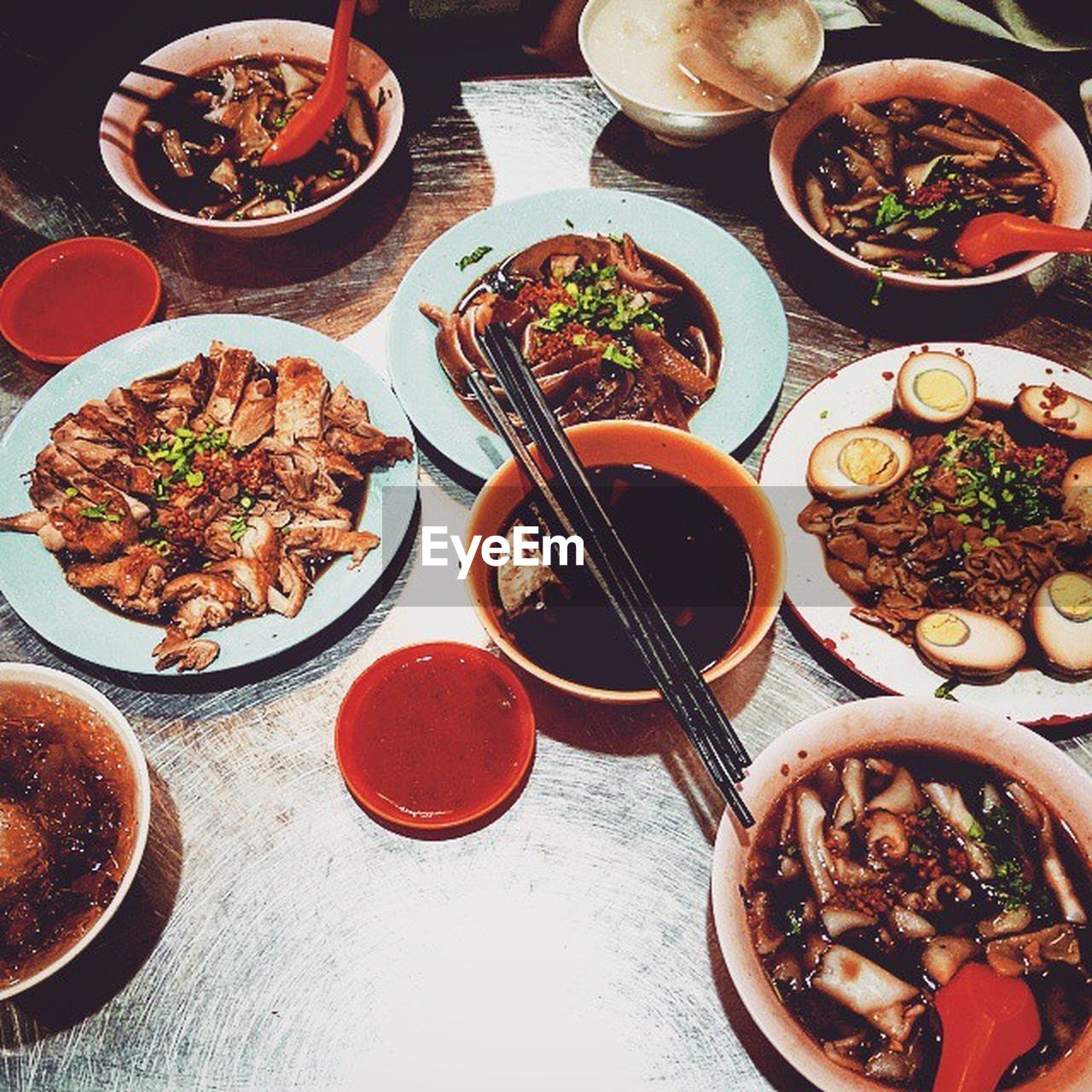 food, food and drink, table, ready-to-eat, serving size, high angle view, bowl, indoors, meat, healthy eating, plate, no people, soup, chopsticks, chinese food, meal, freshness, day, close-up
