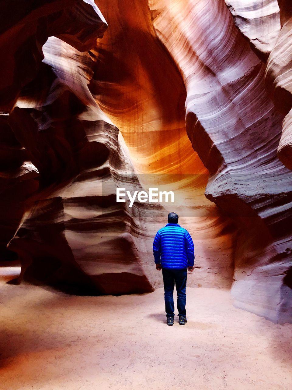 Rear View Of Man Standing At Antelope Canyon