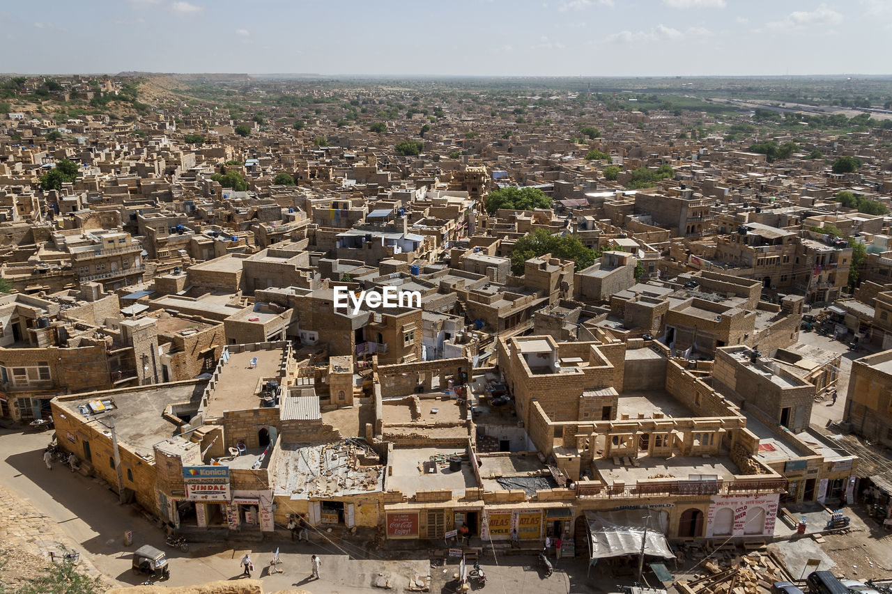architecture, built structure, building exterior, cityscape, city, building, residential district, sky, crowd, high angle view, crowded, day, horizon, nature, outdoors, travel destinations, town, aerial view, house, townscape, settlement