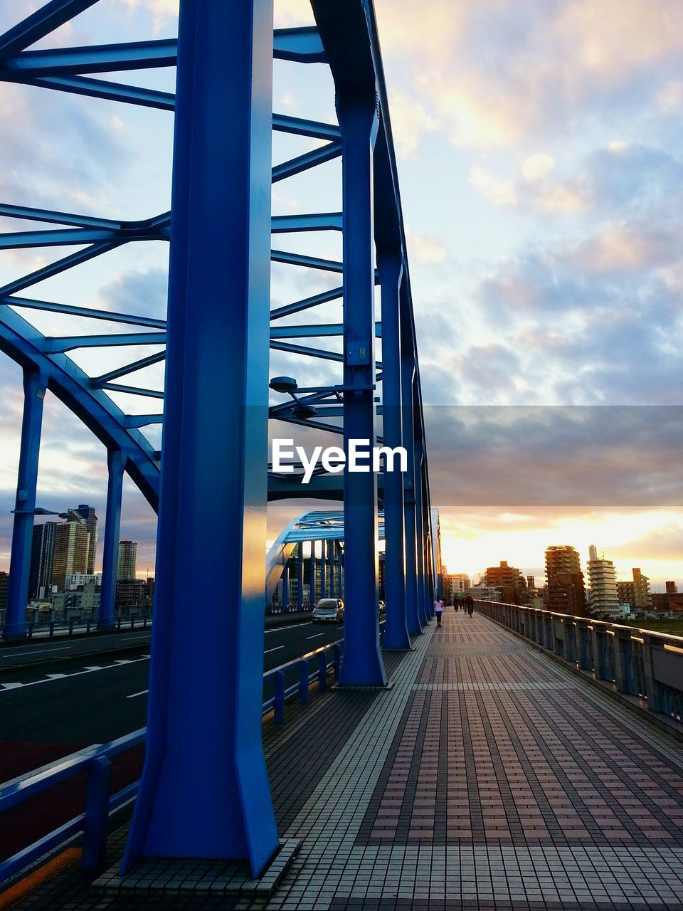 architecture, built structure, sky, cloud - sky, sunset, transportation, building exterior, nature, bridge, city, connection, metal, outdoors, no people, bridge - man made structure, the way forward, direction, railing, building, modern
