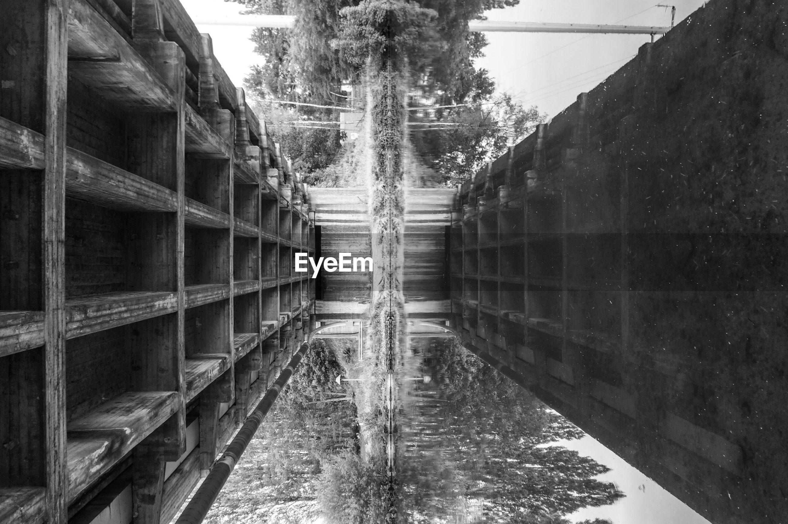 Reflection of wooden bridge in water