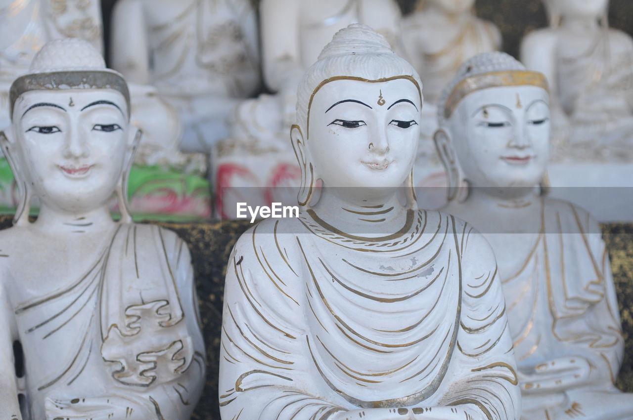 CLOSE-UP OF BUDDHA STATUE IN SHOP