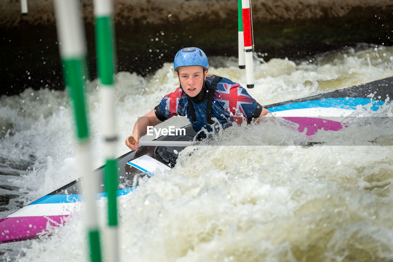 Woman kayaking at river