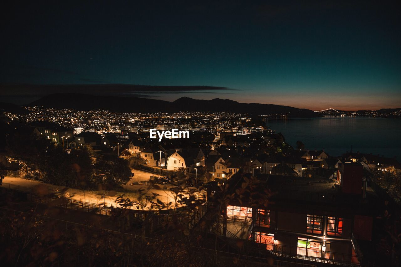building exterior, architecture, built structure, sky, water, city, high angle view, night, illuminated, nature, no people, cityscape, building, sea, residential district, copy space, town, mountain, clear sky, outdoors, townscape