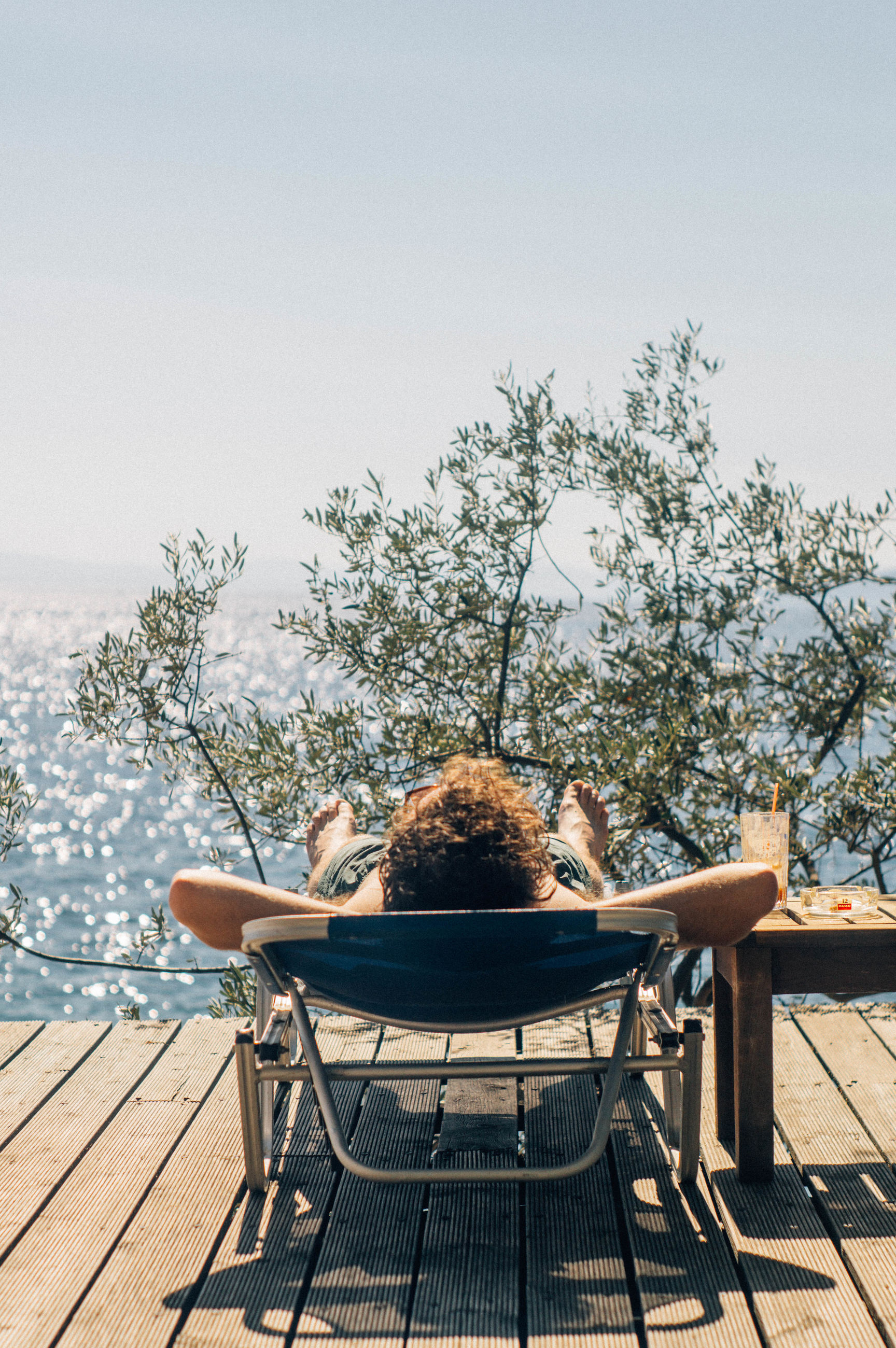 Rear view of man relaxing outdoors
