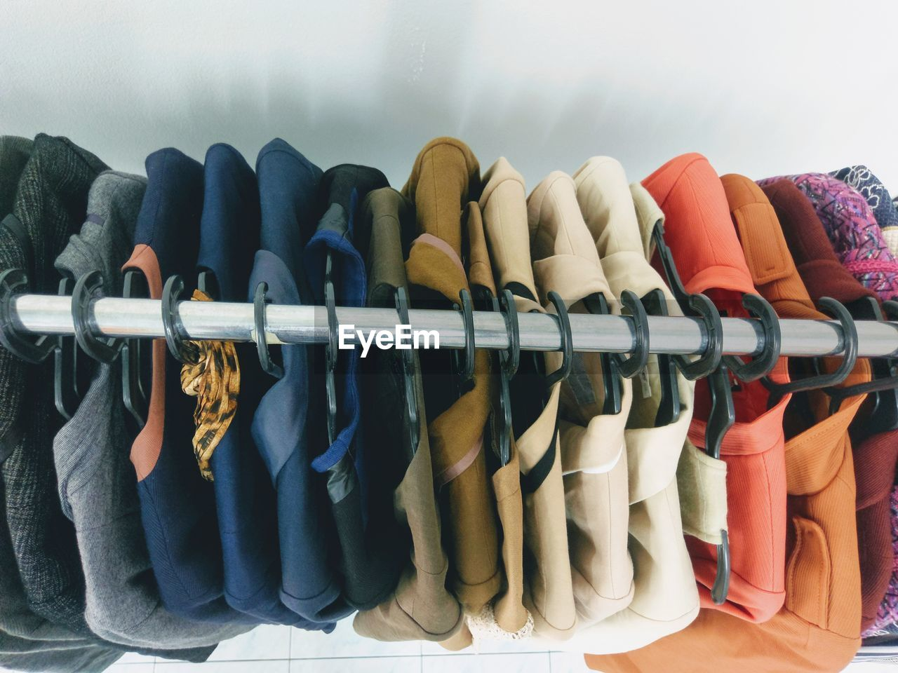 Suit tops on multiple sizes of hangers