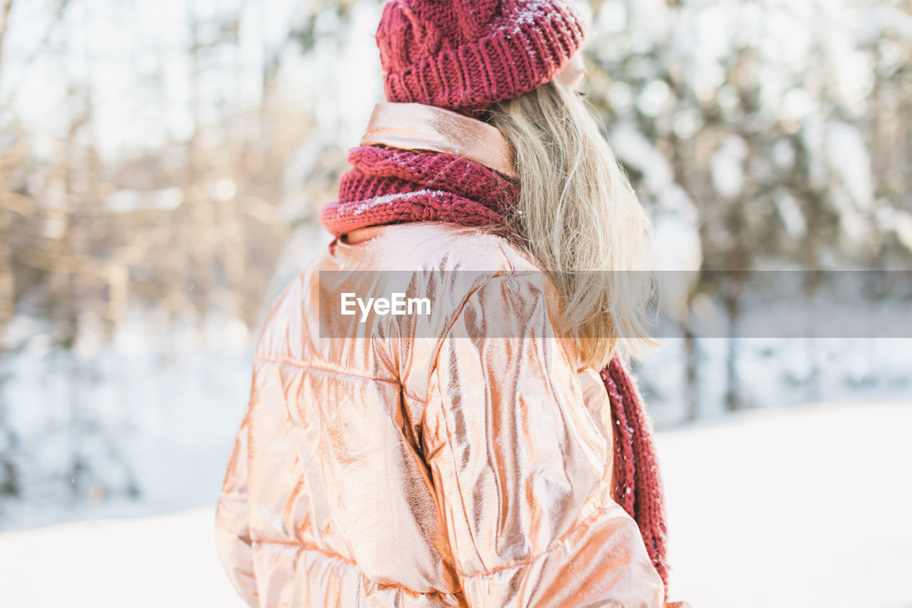 Rear View Of Woman Against Trees On Snowy Field