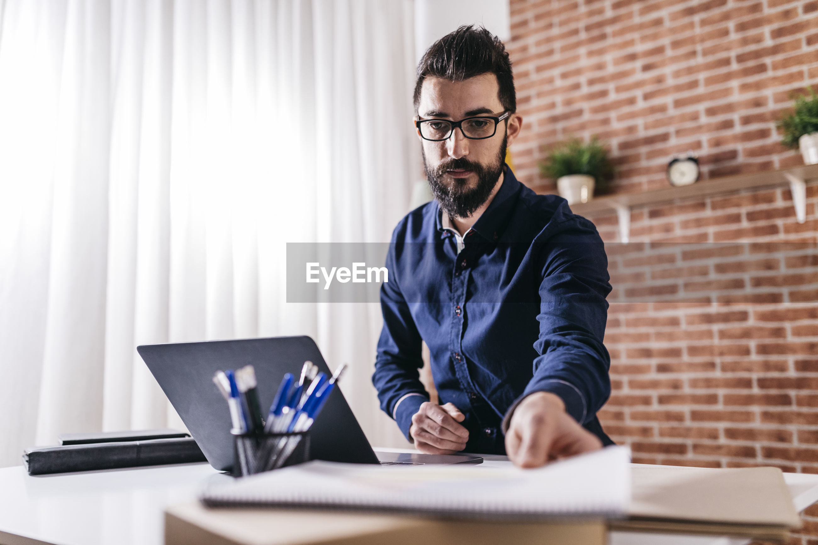 Businessman working at table in office