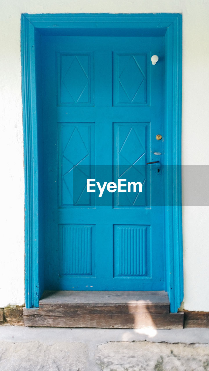 door, entrance, built structure, architecture, building exterior, building, closed, blue, house, day, safety, residential district, no people, security, window, protection, wall - building feature, outdoors, wood - material, front door, turquoise colored, window frame
