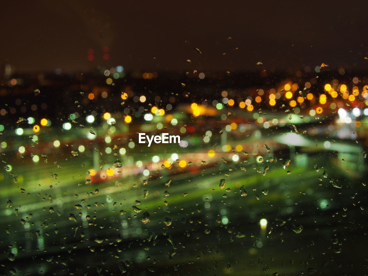 Water Drops On Glass Window At Night