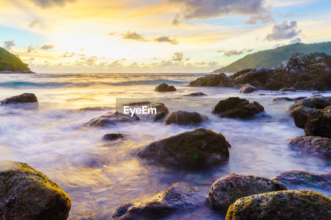 water, rock, sky, beauty in nature, scenics - nature, sea, solid, rock - object, motion, cloud - sky, sunset, land, beach, nature, tranquil scene, tranquility, no people, long exposure, idyllic, horizon over water, outdoors, flowing water