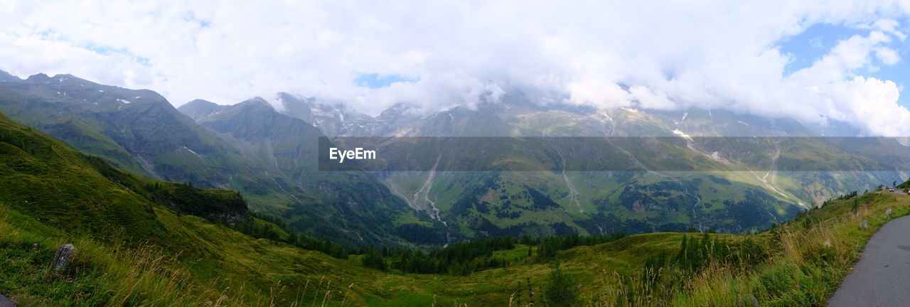 mountain, landscape, sky, beauty in nature, environment, cloud - sky, scenics - nature, mountain range, tranquil scene, nature, panoramic, non-urban scene, tranquility, no people, idyllic, mountain peak, land, plant, day, outdoors, range