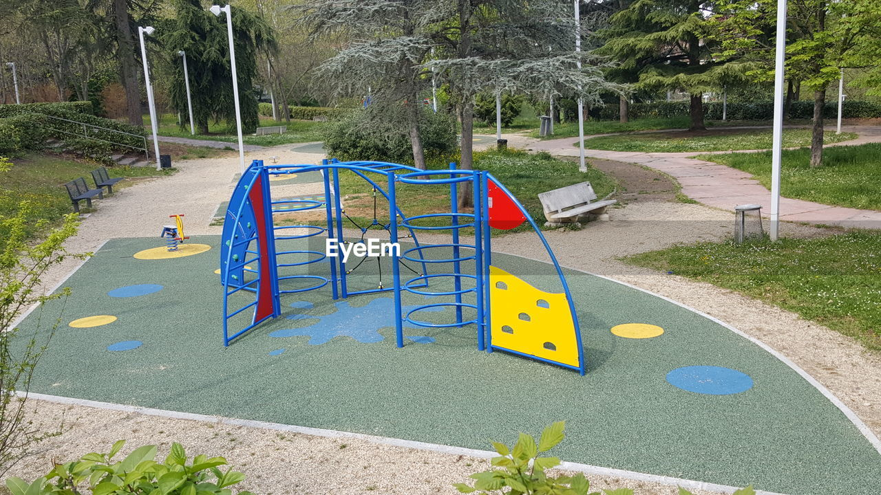 plant, playground, tree, park, nature, day, childhood, park - man made space, grass, yellow, empty, outdoor play equipment, growth, absence, sunlight, outdoors, slide, merry-go-round, slide - play equipment