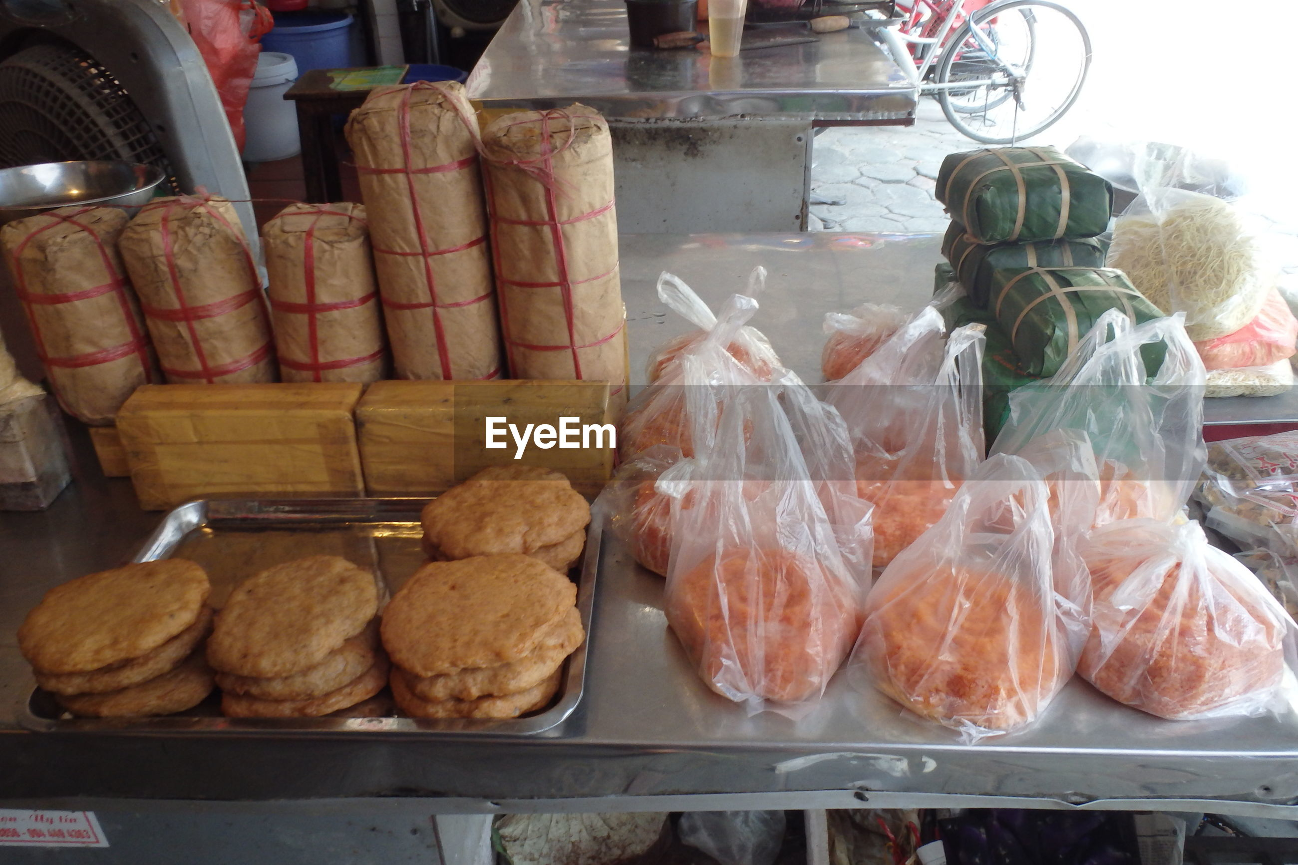 High angle view of food in plastic bags at market stall for sale