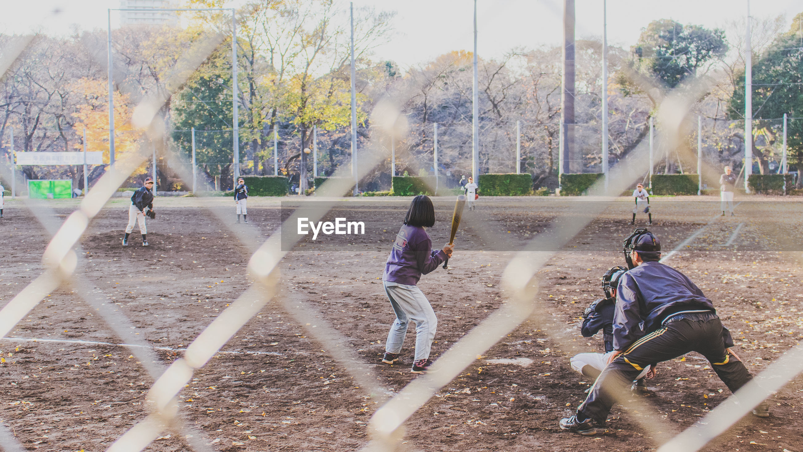 Group of kids practicing baseball