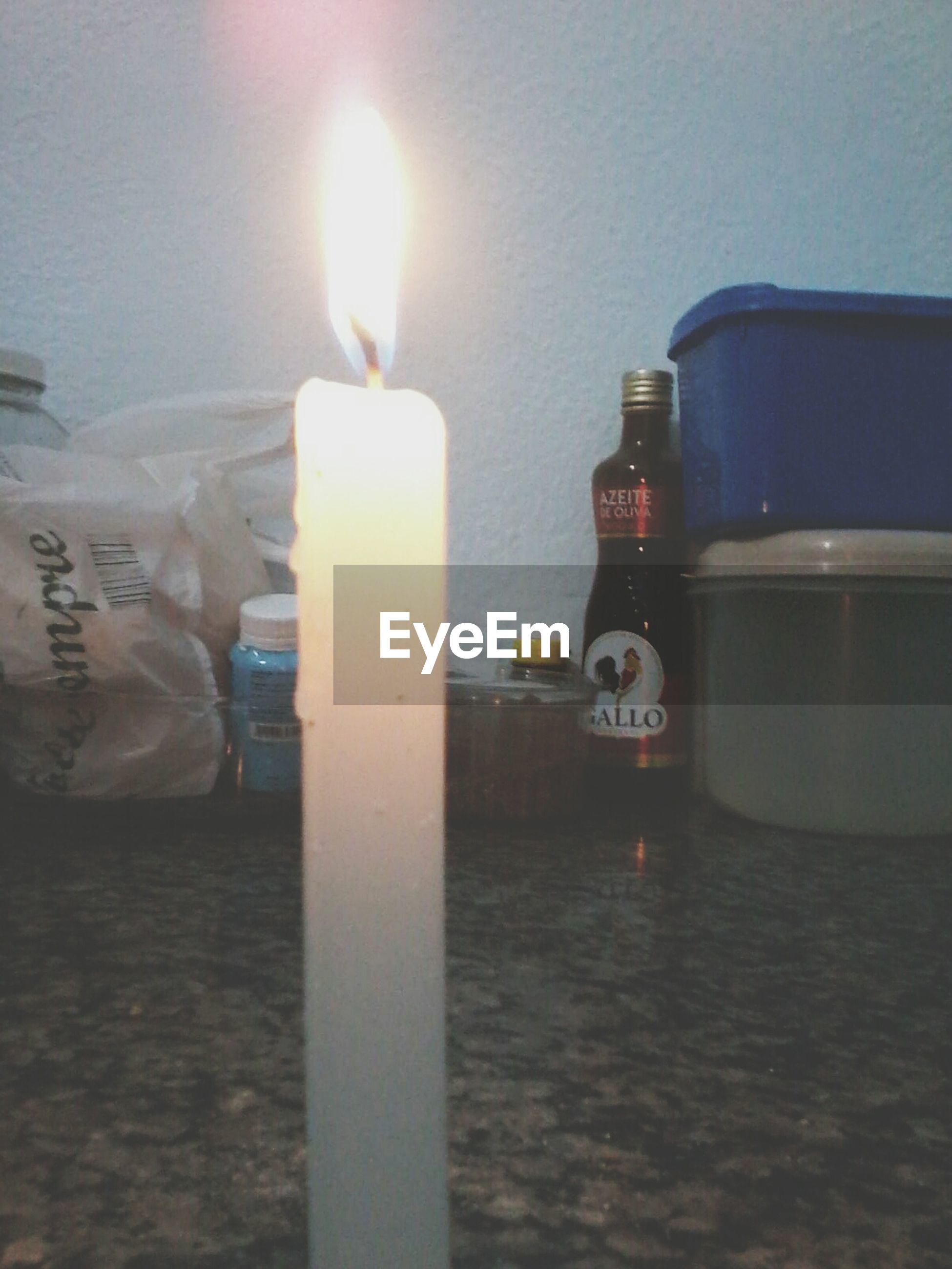 indoors, flame, burning, candle, heat - temperature, fire - natural phenomenon, close-up, still life, table, glowing, focus on foreground, illuminated, no people, candlelight, bottle, lit, selective focus, wood - material, reflection, fire