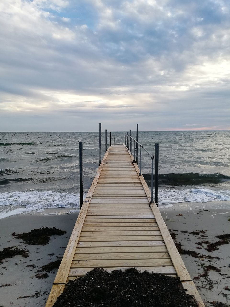 water, sea, sky, horizon, cloud - sky, horizon over water, beauty in nature, scenics - nature, beach, nature, pier, wood - material, direction, land, tranquility, tranquil scene, wave, jetty, the way forward, no people, diminishing perspective, outdoors, long